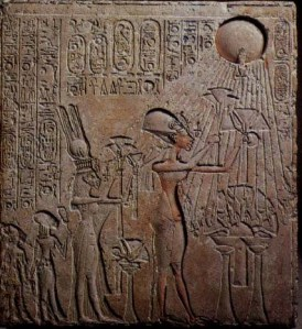 Akhenaten worshiping the sun-disc Aten